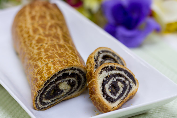 Traditional European yeast pastry dough spread with a sweet poppyseed ...